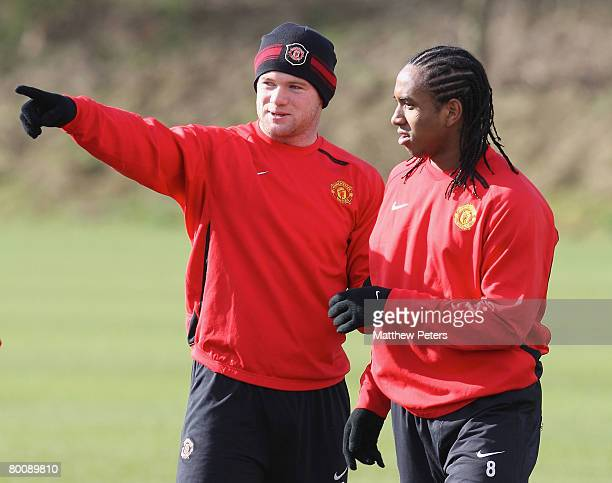 Wayne Rooney and Anderson of Manchester United in action during a First Team training session at Carrington Training Ground on March 3 2008 in...