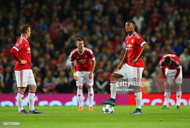 Wayne Rooney and Anthony Martial of Manchester United look dejected as Daniel Caligiuri of VfL Wolfsburg scores their first goal during the UEFA...