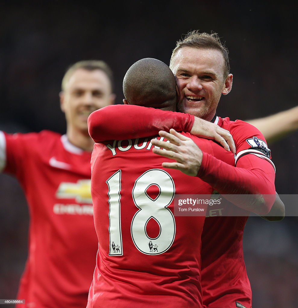 Wayne Rooney and Ashley Young of Manchester United celebrate Juan Mata scoring their second goal during the Barclays Premier League match between Manchester United and Liverpool at Old Trafford on December 14, 2014 in Manchester, England.