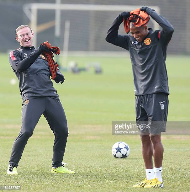 Wayne Rooney and Ashley Young of Manchester United in action during a first team training session ahead of their UEFA Champions League Round of 16...