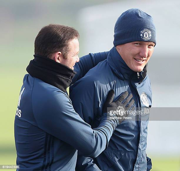 Wayne Rooney and Bastian Schweinsteiger of Manchester United in action during a first team training session at Aon Training Complex on October 31...