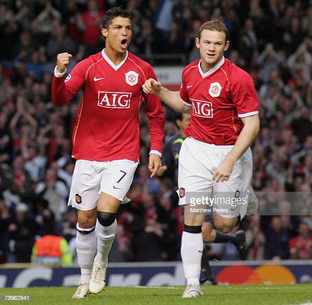 Wayne Rooney and Cristiano Ronaldo of Manchester United celebrate Dida of AC Milan scoring Manchester United's first goal during the UEFA Champions...