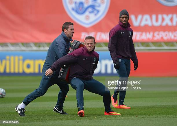 Wayne Rooney and Daniel Sturridge go through drills with Tony Studwick, fitness coach during the England training session at St George's Park on May...