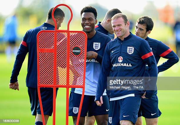 Wayne Rooney and Daniel Sturridge share a joke during the England training session at St Georges Park on October 8, 2013 in Burton-upon-Trent,...