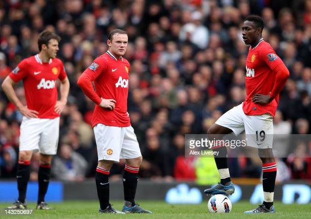 Wayne Rooney and Danny Welbeck of Manchester United look dejected as they prepare to kick off after conceding a fourth goal during the Barclays...