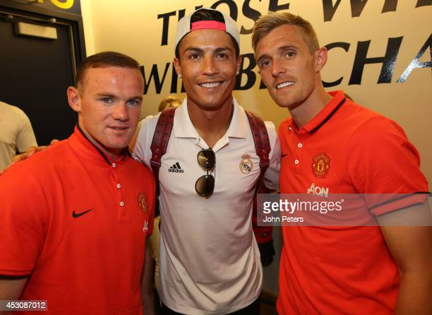 Wayne Rooney and Darren Fletcher of Manchester United pose with Cristiano Ronaldo of Real Madrid after their preseason friendly match against Real...