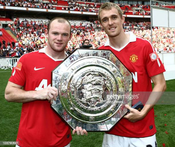 Wayne Rooney and Darren Fletcher pose with the Community Shield after the FA Community Shield match between Chelsea and Manchester United at Wembley...