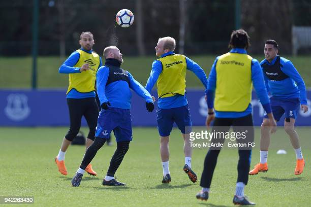 Wayne Rooney and Davy Klaassen challenge for the ball on the ball during the Everton FC training session at USM Finch Farm on April 5 2018 in...