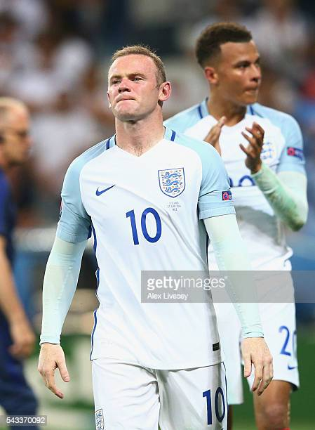Wayne Rooney and Dele Alli of England shows their dejection after their team's 12 defeat in the UEFA EURO 2016 round of 16 match between England and...