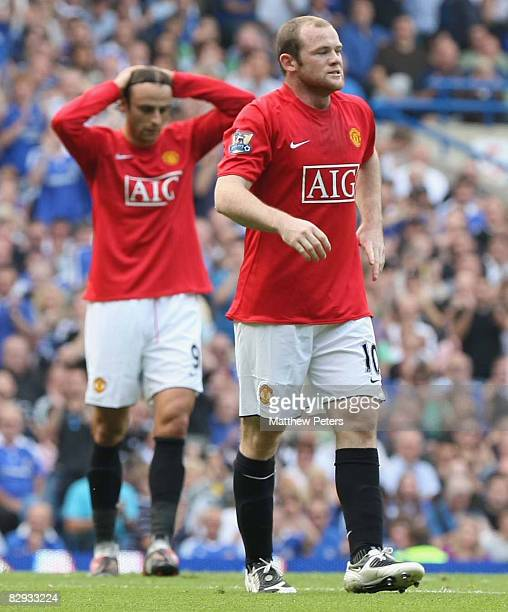 Wayne Rooney and Dimitar Berbatov of Manchester United shows their disappointment at a missed chance during the FA Premier League match between...