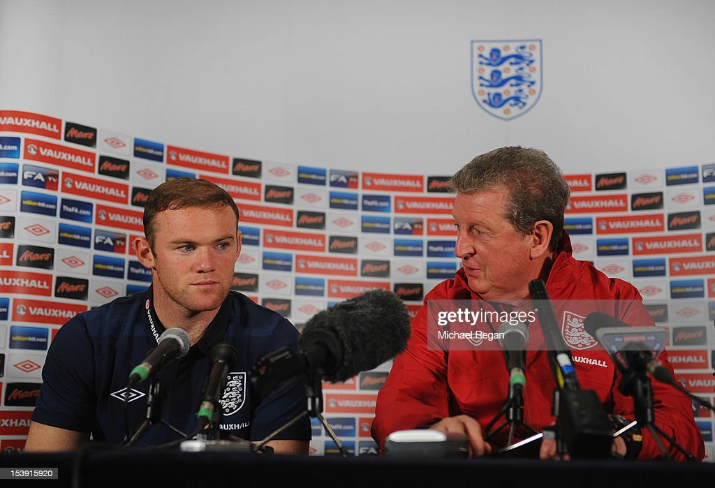 Wayne Rooney and England manager Roy Hodgson speak to the media during the England press conference ahead of their FIFA World Cup qualifier against San Marino at The Grove Hotel on October 11, 2012 in Watford, England.
