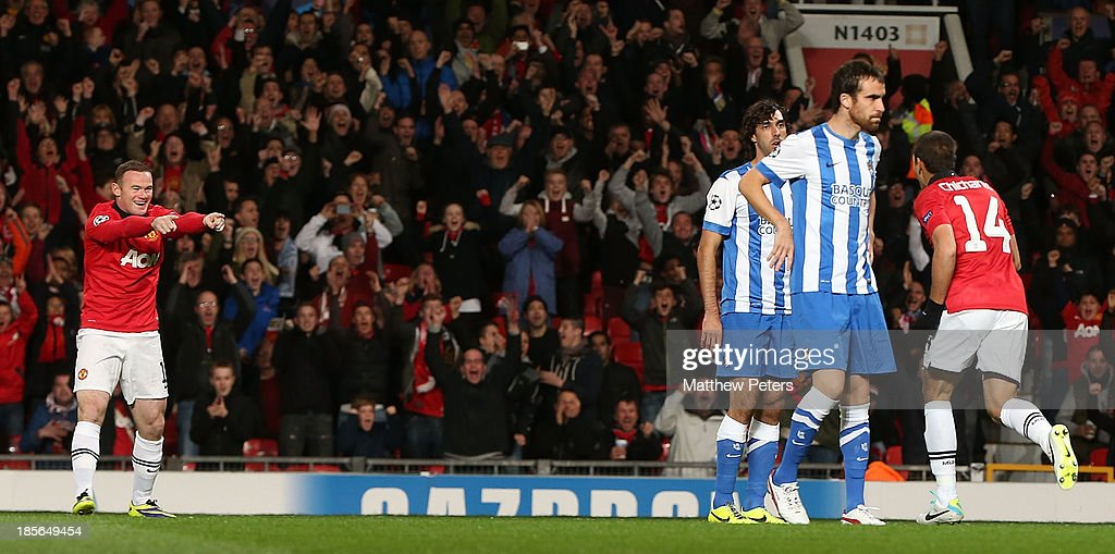 Wayne Rooney and Javier 'Chicharito' Hernandez of Manchester United celebrate Carlos Martinez of Real Sociedad scoring an own-goal during the UEFA Champions League Group A match between Manchester United and Real Sociedad at Old Trafford on October 23, 2013 in Manchester, England.