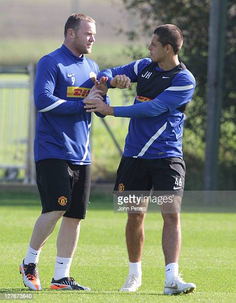 Wayne Rooney and Javier Hernandez of Manchester United in action during a first team training session at Carrington Training Ground on September 30...