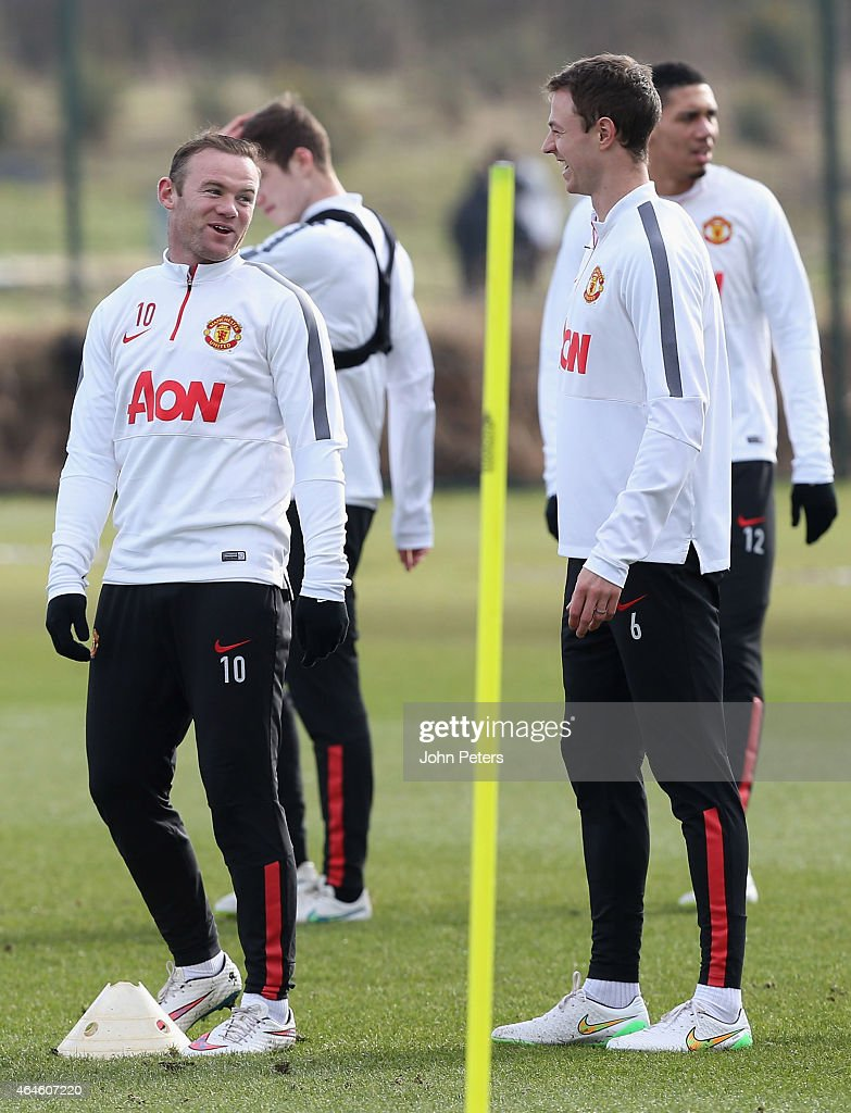 Wayne Rooney and Jonny Evans of Manchester United in action during a first team training session at Aon Training Complex on February 27, 2015 in Manchester, England.