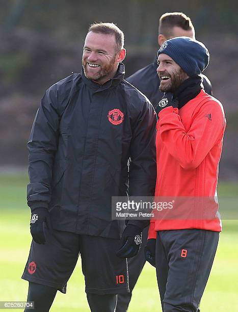 Wayne Rooney and Juan Mata of Manchester United in action during a first team training session at Aon Training Complex on November 23, 2016 in...