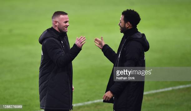 Wayne Rooney and Liam Rosenior Co-Interim Managers of Derby County celebrate after Duane Holmes scores their first goal during the Sky Bet...