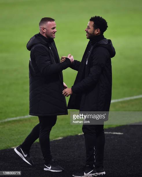Wayne Rooney and Liam Rosenio,r Co-Interim Managers of Derby County celebrate after Duane Holmes scores their first goal during the Sky Bet...