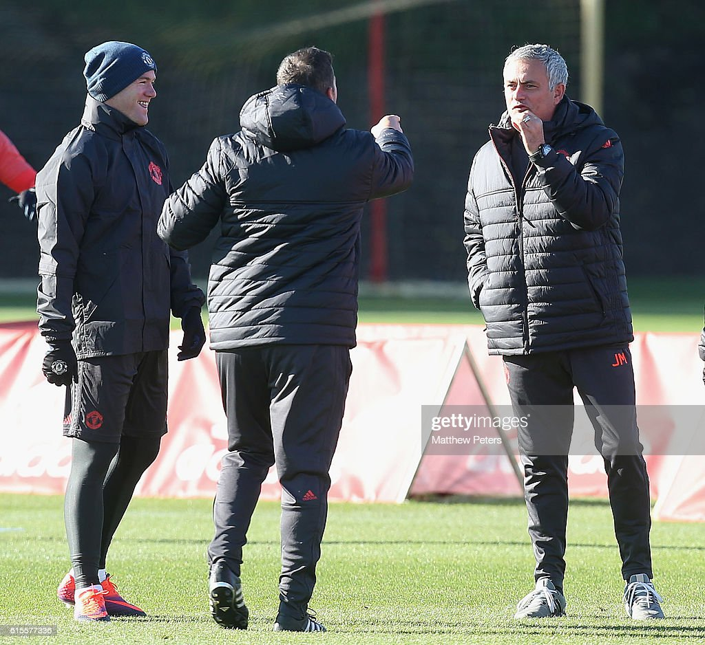 Wayne Rooney and Manager Jose Mourinho of Manchester United in action during a first team training session at Aon Training Complex on October 19, 2016 in Manchester, England.