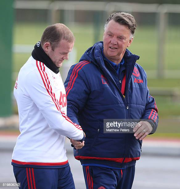 Wayne Rooney and Manager Louis van Gaal in action during a first team training session at Aon Training Complex on April 8 2016 in Manchester England