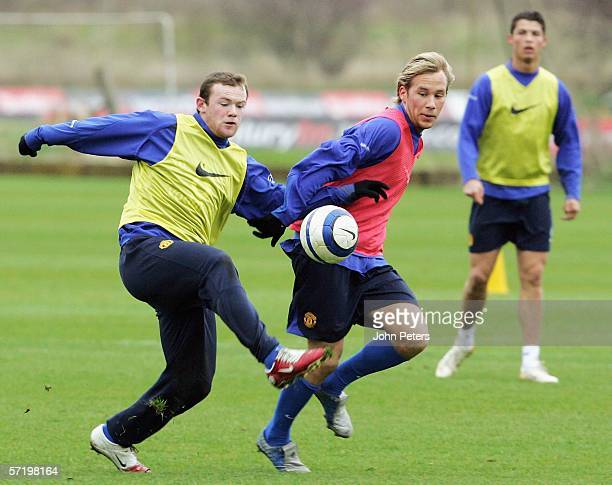 Wayne Rooney and Markus Neumayr of Manchester United in action during a first team training session at Carrington Training Ground on March 28 2006,...