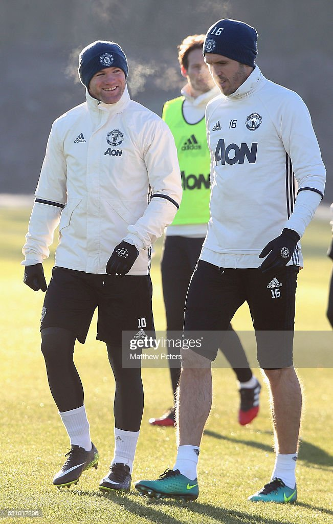 Wayne Rooney and Michael Carrick of Manchester United in action during a first team training session at Aon Training Complex on January 5, 2017 in Manchester, England.