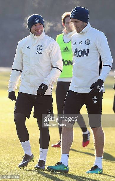 Wayne Rooney and Michael Carrick of Manchester United in action during a first team training session at Aon Training Complex on January 5 2017 in...