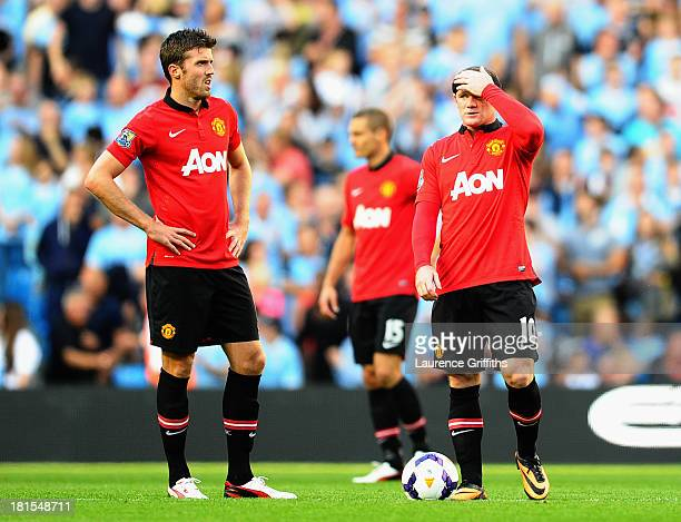 Wayne Rooney and Michael Carrick of Manchester United look dejected during the Barclays Premier League match between Manchester City and Manchester...