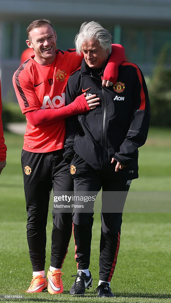 Wayne Rooney and Opposition coach Marcel Bout of Manchester United in action during a first team training session at Aon Training Complex on September 26, 2014 in Manchester, England.