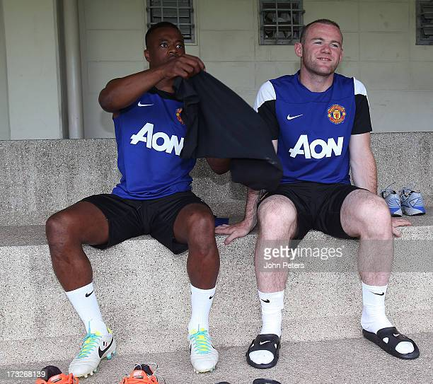 Wayne Rooney and Patrice Evra of Manchester United attend a first team training session at Royal Bangkok Sports Club as part of their preseason tour...