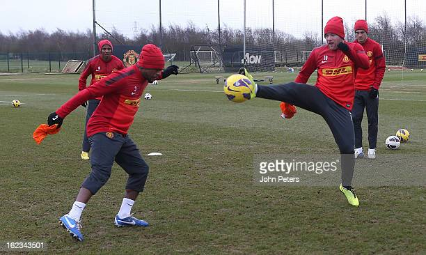 Wayne Rooney and Patrice Evra of Manchester United in action during a first team training session at Carrington Training Ground on February 22 2013...