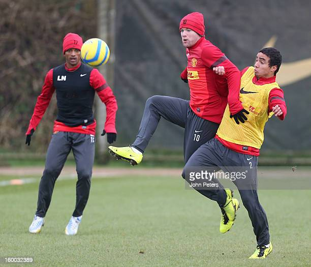 Wayne Rooney and Rafael da Silva of Manchester United in action during a first team training session at Carrington Training Ground on January 25,...