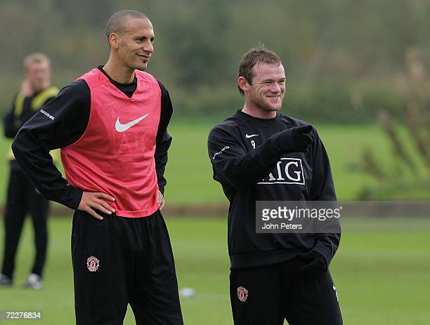 Wayne Rooney and Rio Ferdinand of Manchester United in action during a first team training session at Carrington Training Ground on October 27 2006,...