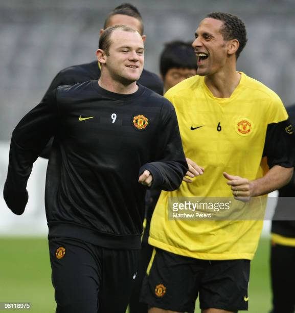 Wayne Rooney and Rio Ferdinand of Manchester United in action during a First Team Training Session ahead of their UEFA Champions League QuarterFinal...