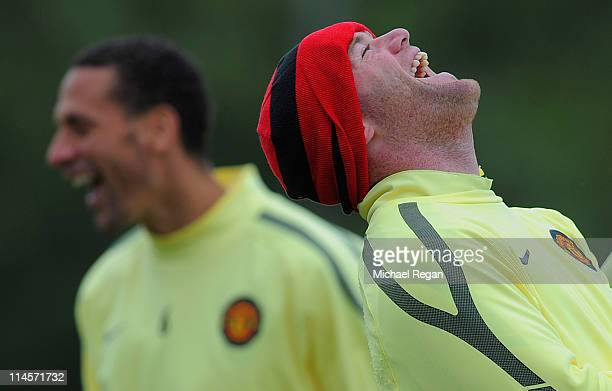 Wayne Rooney and Rio Ferdinand share a laugh during the Manchester United training session ahead of the UEFA Champions League Final against Barcelona...