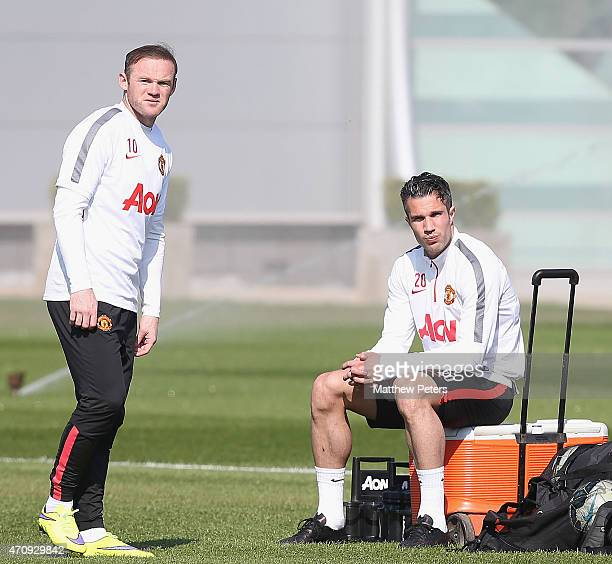 Wayne Rooney and Robin van Persie of Manchester United in action during a first team training session at Aon Training Complex on April 24, 2015 in...