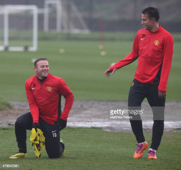 Wayne Rooney and Robin van Persie of Manchester United in action during a first team training session ahead of their UEFA Champions League Round of...