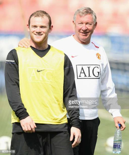 Wayne Rooney and Sir Alex Ferguson of Manchester United during a first team training session during their pre-season tour to South Africa at Loftus...