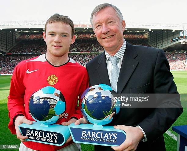 Wayne Rooney and Sir Alex Ferguson of Manchester United pose with their Barclays Player of the Month and Manager of the Month awards ahead of the...