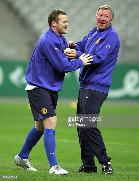 Wayne Rooney and Sir Alex Ferguson of Manchester United share a laugh during a first team training session ahead of the UEFA Champions League match...