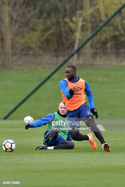 Wayne Rooney and Yannick Bolasie challenge for the ball during the Everton FC training session at USM Finch Farm on April 17 2018 in Halewood England
