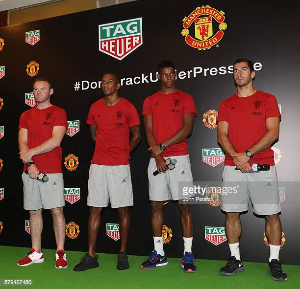 Wayne Rooney Ashley Young Marcus Rashford and Henrikh Mkhitaryan of Manchester United pose at the official launch of Manchester United's partnership...