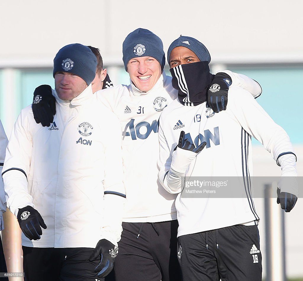 Wayne Rooney, Bastian Schweinsteiger and Ashley Young of Manchester United in action during a first team training session at Aon Training Complex on January 5, 2017 in Manchester, England.