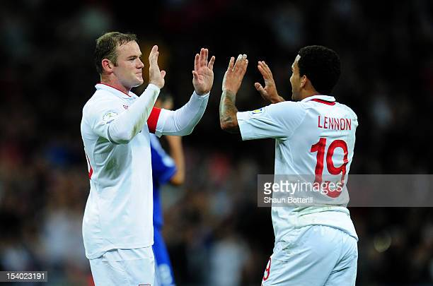 Wayne Rooney captain of England celebrates with teammate Aaron Lennon after scoring his team's third goal during the FIFA 2014 World Cup Group H...