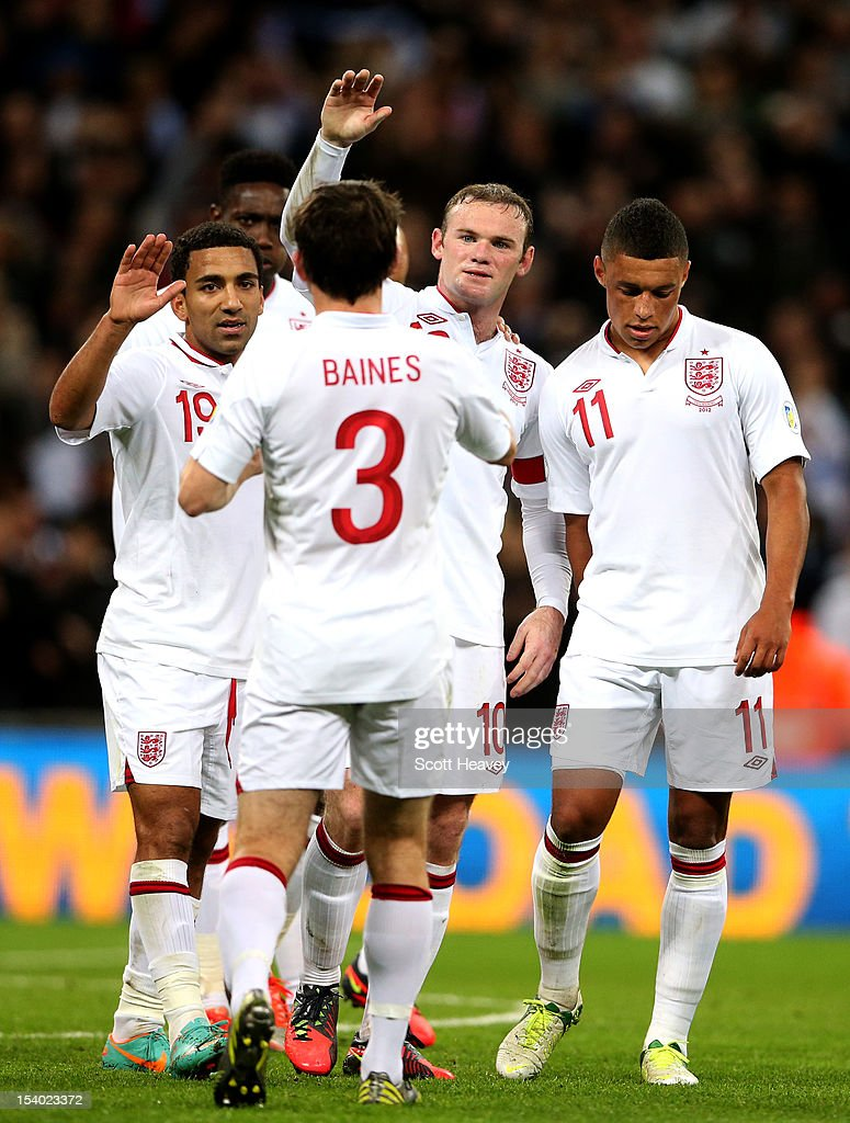 Wayne Rooney captain of England celebrates with (L-R) team-mates Aaron Lennon, Danny Welbeck, Leighton Baines and Alex Oxlade-Chamberlain after scoring his team's third goal during the FIFA 2014 World Cup Group H qualifying match between England and San Marino at Wembley Stadium on October 12, 2012 in London, England.