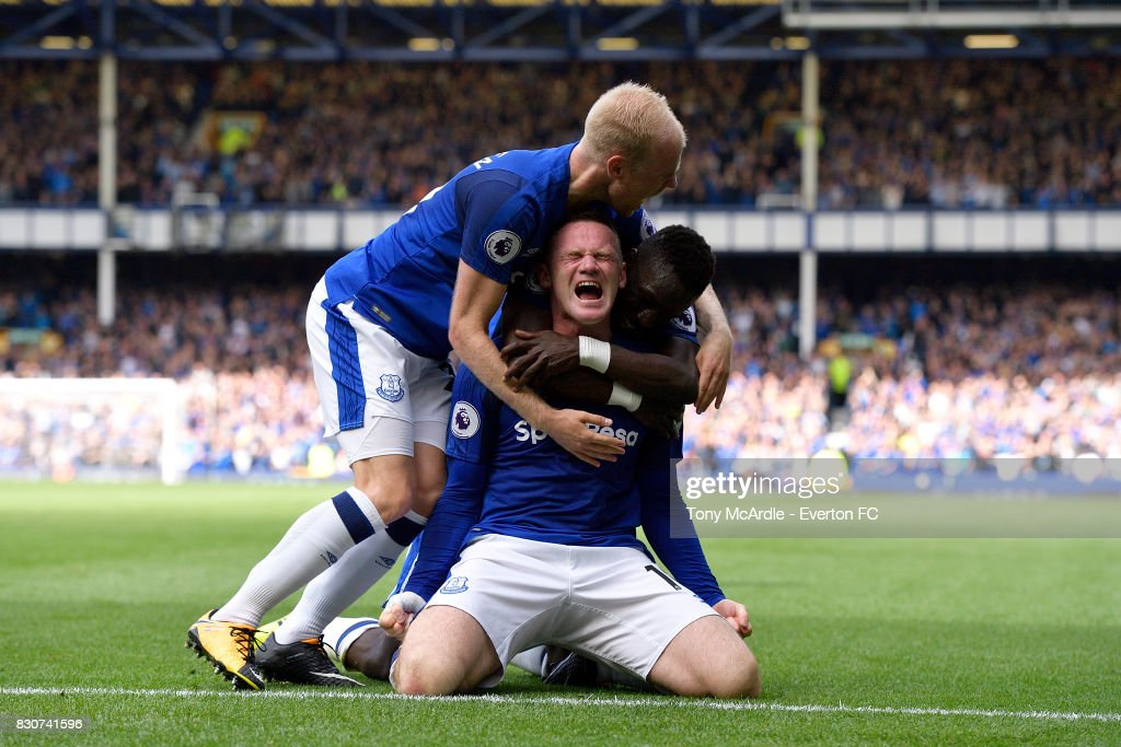 Wayne Rooney celebrates his goal with Davy Klaassen (L) and Idrissa Gueye during the Premier League match between Everton and Stoke City at Goodison Park on August 12, 2017 in Liverpool, England.