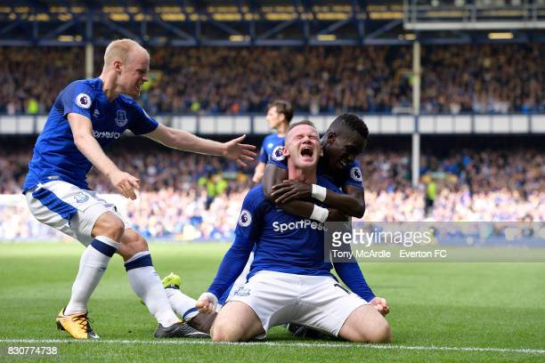 Wayne Rooney celebrates his goal with Davy Klaassen and Idrissa Gueye during the Premier League match between Everton and Stoke City at Goodison Park...