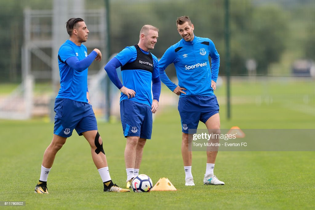 Wayne Rooney (C) chats to Morgan Schneiderlin (R) during the Everton training session at USM Finch Farm on July 10, 2017 in Halewood, England.
