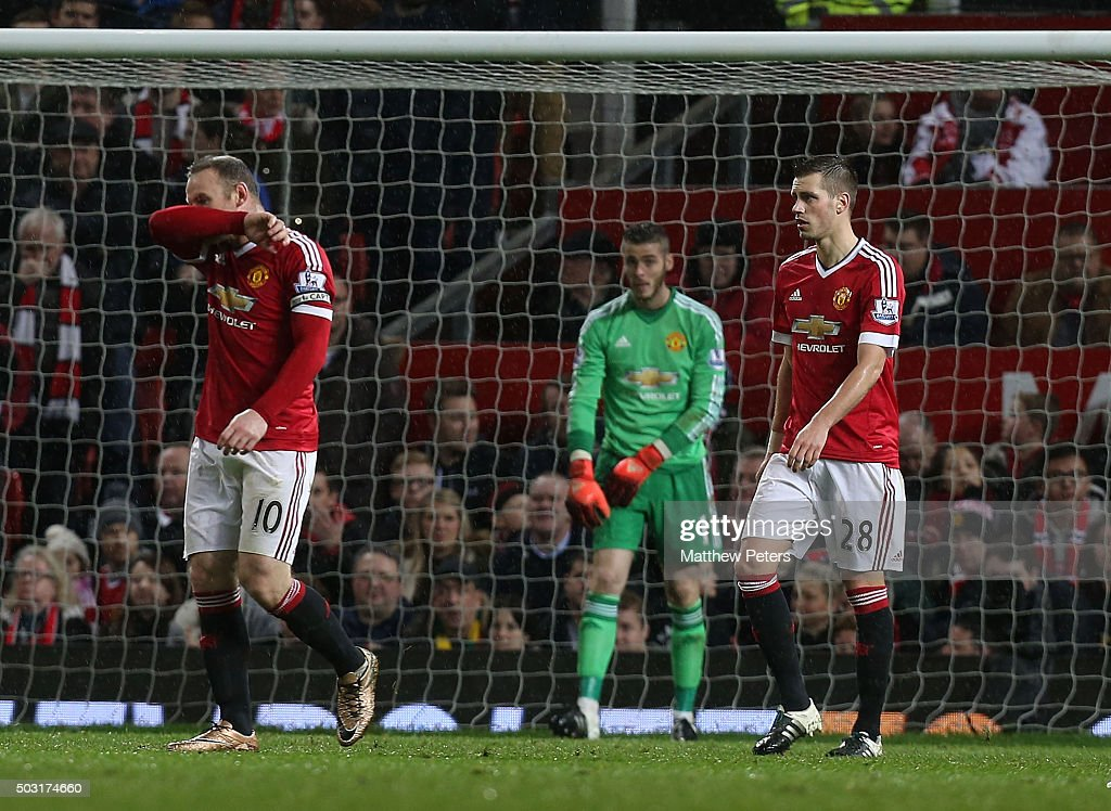 Wayne Rooney, David de Gea and Morgan Schneiderlin of Manchester United show their disappointment at conceding a goal to Gylfi Sigurdsson of Swansea City during the Barclays Premier League match between Manchester United and Swansea City at Old Trafford on January 2, 2016 in Manchester, England.
