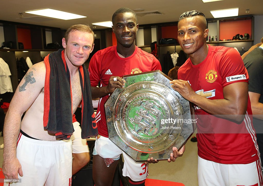 Wayne Rooney, Eric Bailly and Antonio Valencia of Manchester United pose with the Community Shield trophy in the dressing room after the FA Community Shield match between Leicester City and Manchester United at Wembley Stadium on August 7, 2016 in London, England.