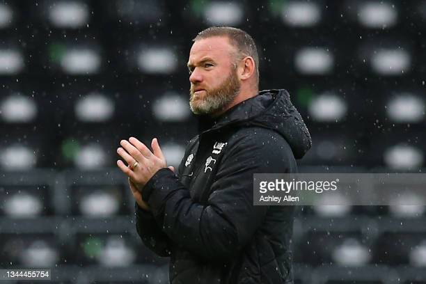 Wayne Rooney, head coach of Derby County applauds the home supporters during the Sky Bet Championship match between Derby County and Swansea City at...